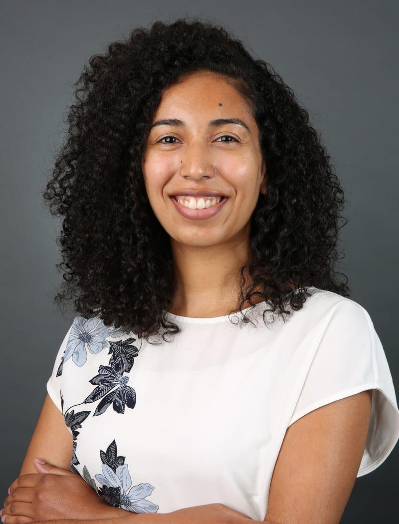 Professional head shot of Adriana Vega-Harris, a queer Black Latinx graduate student