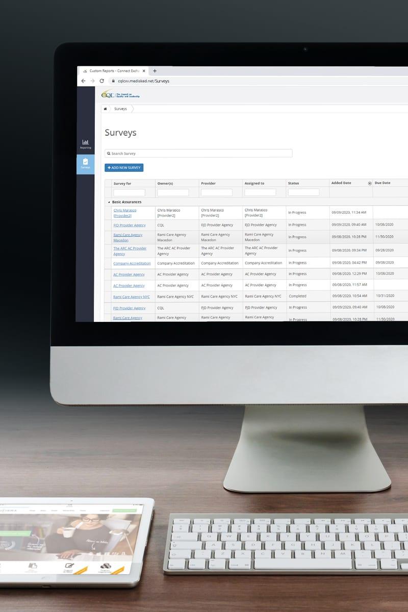 Desktop computer displaying the 'survey grid' screen of PORTAL Data System