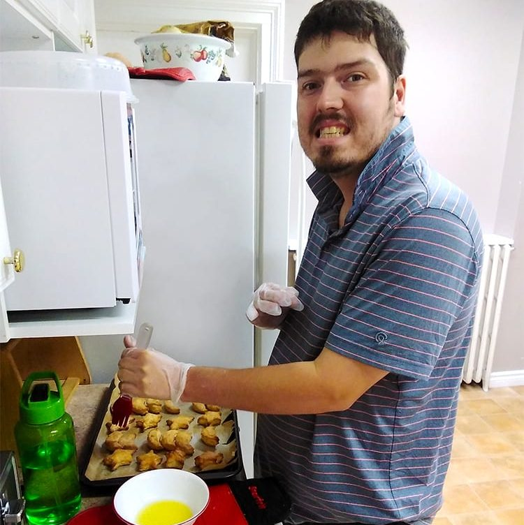Person preparing food in their kitchen at home